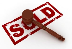 """SOLD"" graphic with gavel"